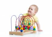 Kid plays with educational toy isolated — Stock Photo