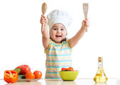 Smiling little cook with ladle, isolated on white — Stock Photo