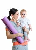 Mother holding baby ready to fitness — Stock Photo