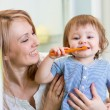 Mother and little son brushing teeth in bathroom — Stock Photo #66325745