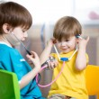 Kids boys play doctor at home — Stock fotografie #66931491
