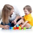 Kid boy and mother play together with construction set toy — Stock Photo #67170561
