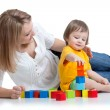 Kid boy and mother play together with construction set toy — Stock Photo #67514159