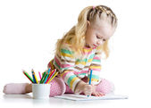 Cheerful child girl drawing with pencils in preschool — Stock Photo