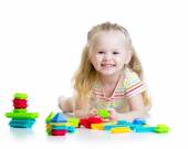 Portrait of sweet little girl with toy blocks — Stock Photo