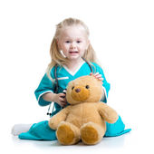 Kid girl playing doctor with plush toy — Foto Stock