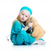 Girl playing doctor with toy — Stock Photo