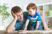 Boy and father read  book — Stock Photo