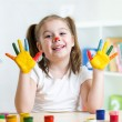Cute child painting her hands — Stock Photo #69746203