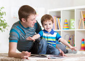 Happy father read a book to child — Stock Photo