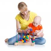 Kid and mother play with educational toy — Stock Photo