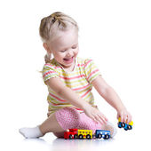 Child girl playing with color toys — Stock Photo