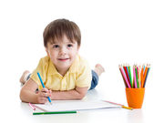 Cute child boy drawing with pencils in preschool isolated — Stock Photo