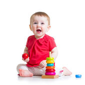Child baby playing with color pyramid toy — Stock Photo