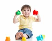 Smiling child boy playing with color toys — Stock Photo