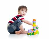 Little child with construction set over white backgroun — Stock Photo