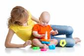 Kid boy and mother play together with pyramid toy — Stock Photo