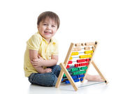 Child playing with abacus toy — Stock Photo