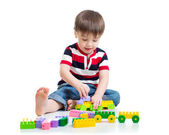 Portrait of little boy with toy blocks — Stock Photo