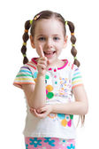 Child girl counting and showing forefinger — Stock Photo