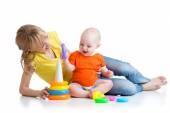 Baby boy and mother play together with toy — Stock Photo
