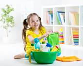 Cute little girl cleanses a floor — Stock Photo