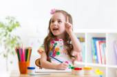 Dreamy child girl with pencils — Stock Photo