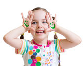 Happy kid girl showing painted hands with funny face — Stock Photo