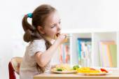 Preschooler kid eating healthy food at home — Stock Photo