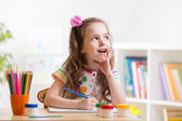Dreamy kid girl with pencils — Stock Photo