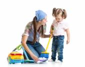 Little girl and mom cleaning room — Stock Photo