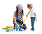 Child girl and mom cleaning room — Stock Photo