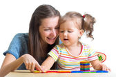 Child and mom playing together with toys — Stock Photo