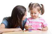 Child and mother playing together with puzzle toy — Stock Photo