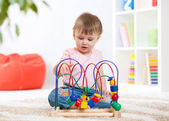 Funny toddler girl playing with educational toy indoor — Stock Photo