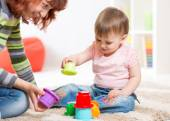 Mother and kid playing block toys at home — Stock Photo