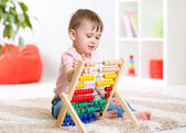 Kid girl playing with counter — Stock Photo