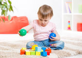 Child toddler playing wooden toys at home — Stock Photo
