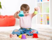 Child playing with toys indoor — Stock Photo