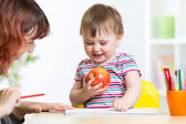 Happy child and mother draw with colorful pencils — Stock Photo