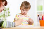 Child girl drawing with pencils in preschool — Stock Photo