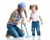 Child little girl and mom cleaning room — Stock Photo