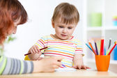 Cute little preschooler child drawing at house — Stock Photo
