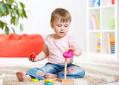 Portrait of sweet little girl with toy — Stock Photo