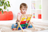 Child girl playing with counter — Stock Photo
