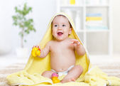 Adorable happy baby girl in towel — Stock Photo
