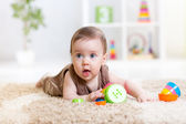 Baby girl playing with toys indoor — Stock Photo