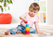 Child girl playing with toy at home — Stock Photo
