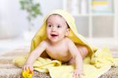 Cute baby with a towel after the shower at home — Stock Photo