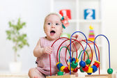 Kid plays with educational toy — Stock Photo